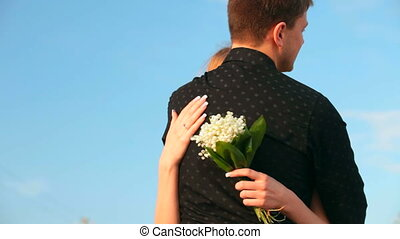 romantic couple against blue sky
