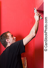 Painter working on wall