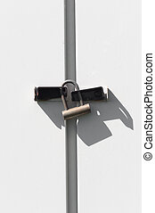 Modern lock on white metal door