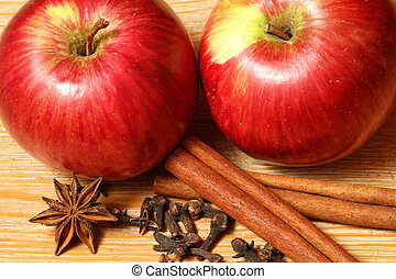 apples with spices - two juicy apples with spices on the...