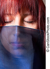 Girl in scarf with closed eyes