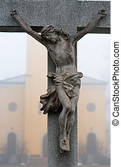 Stone cross with Jesus Christ crucifixion