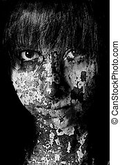 Dark art portrait of a girl with cracks and old paint in black and white