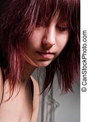 Beautiful young girl looking depressed