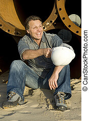 happy construction worker chatting towards a colleaugue.