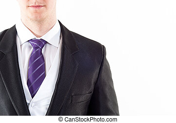 Young buisnessman with purple tie on white background