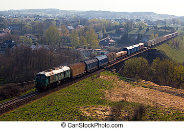Freight train passing the hilly landscape