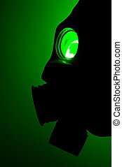 Silhouette of a gas mask in green light