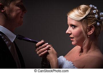 Bride pulling her husband