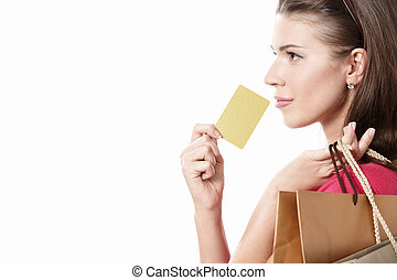 Buyer - Young girl with a credit card and shopping bags on...