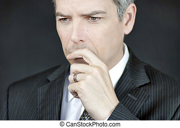 Businessman Ponders - Close-up of a businessman in deep...