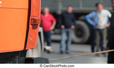 Accident on urban road - Truck towing a damaged vehicle on...