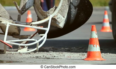 Road cone at accident site. Cement mixer truck crash