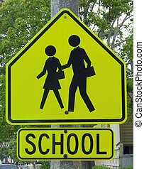 School Zone Sign - A School Zone Sign warns motorists to...