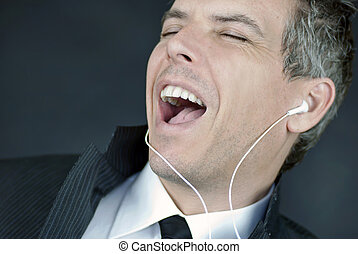 Businessman Wearing Headphones Sings