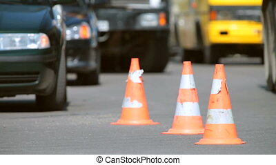 Traffic cones at accident site in the background cars with...