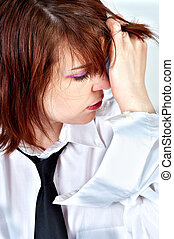 young business woman holding her head