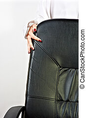 Business chair with a hand of a girl