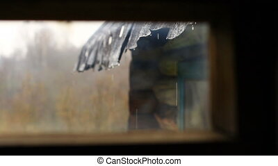 Rain through the rural house window