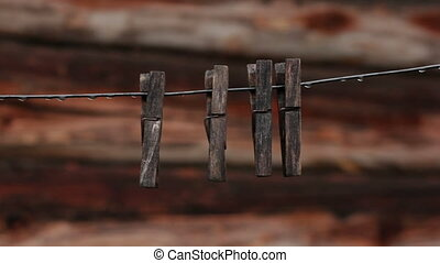 Vintage clothes pegs hanging on a rope