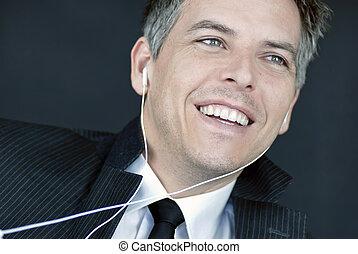 Laughing Businessman Wearing Headphones