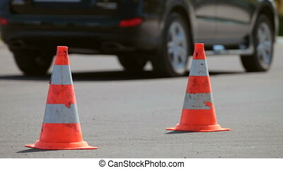 Traffic cone in the background moving cars