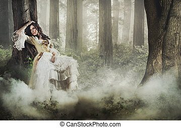 Fine art photo of a gorgeous lady in a mysterious foggy...
