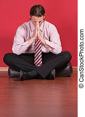 Business executive sitting on the floor