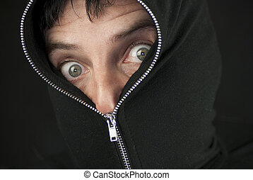 Zipped To The Nose - Close-up of a shocked man with the hood...
