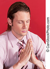 Closeup of a businessman in prayer posture
