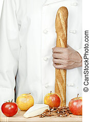 Chef Holds Baguette