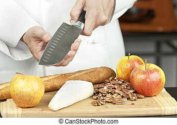 Chef Tests Knife Sharpness - Close-up of a chef testing...