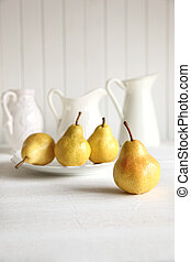 Fresh pears on old table