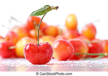 Sweet cherries with droplets isloated on white
