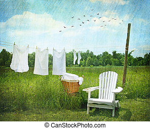 Laundry drying on clothesline on beautiful summers day