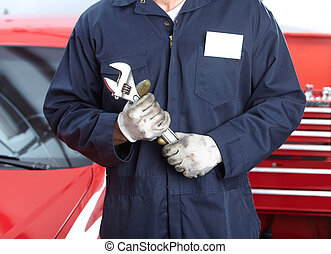 Auto repair - Mechanic with wrench. Auto repair shop...