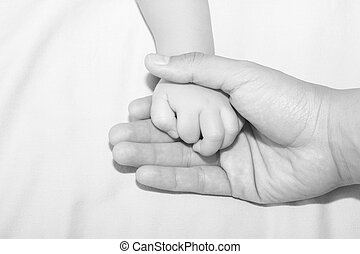 Father holding daughters hand