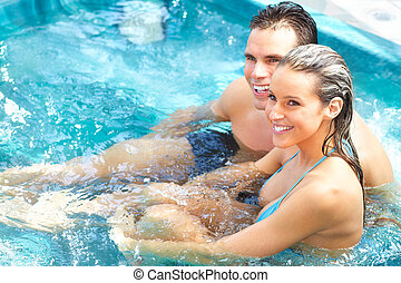 Couple - Young couple relaxing in the water.  Summer.