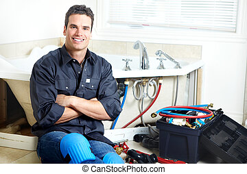 Plumber - Young plumber in the bath room Repair
