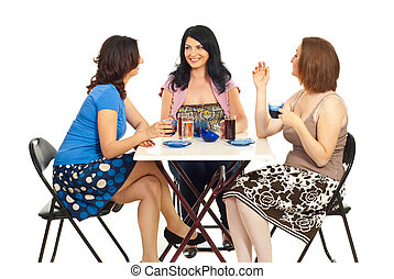 Group of women chatting at table - Group of three women...