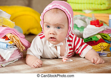 baby girl with children's clothes - baby girl with stacked...