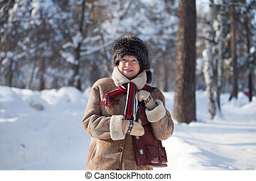 woman in winter park - Portrait of mature woman in winter...