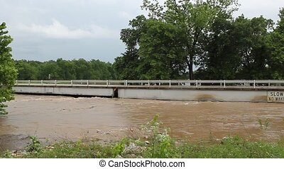 The River Is Rising - This is a new bridge that crosses the...