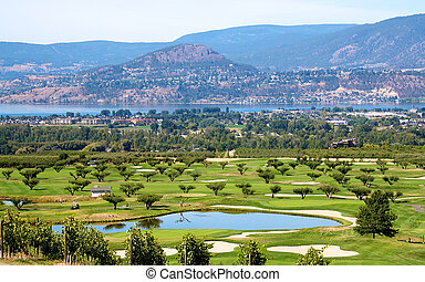 Golf course in the Okanagan valley set among vineyards and...