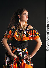 Young girl dance in gypsy costume - Young girl dance in...