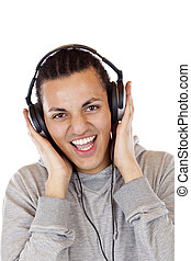 Smiling dark-skinned teenager with earphones listens to mp3 music