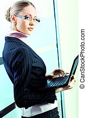 company - Beautiful business woman is working at the office