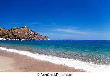 Beach at Tindari gulf with Shrine of Our Lady on the cliff on background, Sicily, Italy