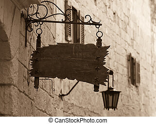 Retro photo of old wooden signboard on old mediterranean...