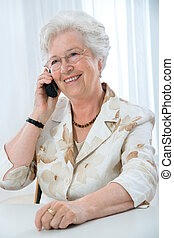mature woman using telephone - portrait of a mature woman...